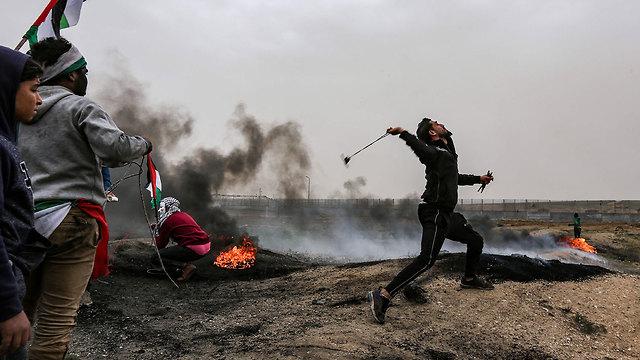 התפרעויות פלסטינים עזה (צילום: AFP)