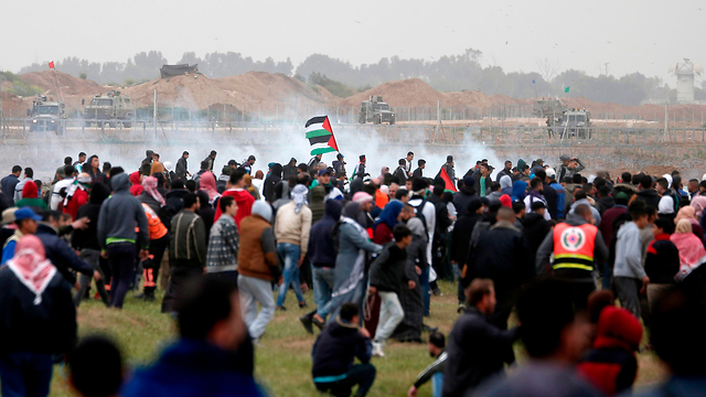 Palestinian protests along Gaza fence, March 30, 2019. Stewards in orange tabards kept people away from the fence (Photo: AFP)
