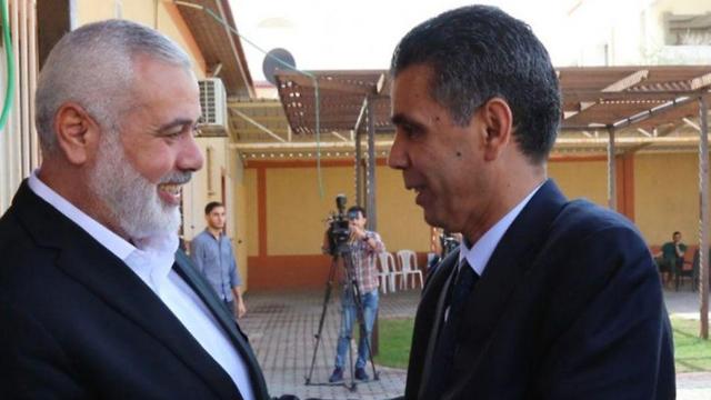 Egyptian intelligence officer Gen. Ahmed Abdel-Khalek and Hamas leader Ismail Haniyeh