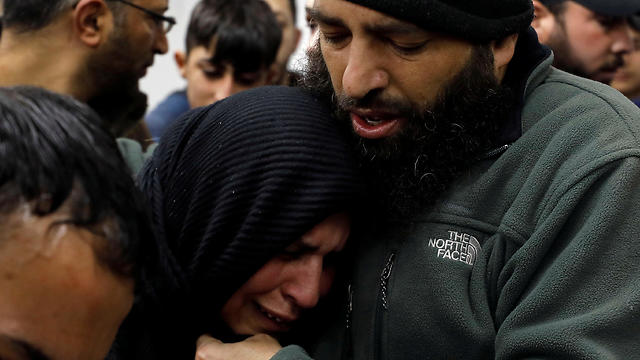 The mother of a Palestinian man killed during an IDF raid mourns at a hospital in Ramallah, April 2, 2019.