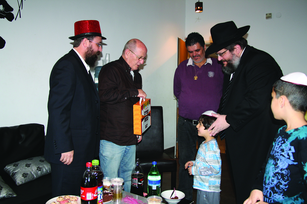 Chabad activists visiting the family of a teenager murdered in a terror attack (Photo: Chabad Youth Organization)