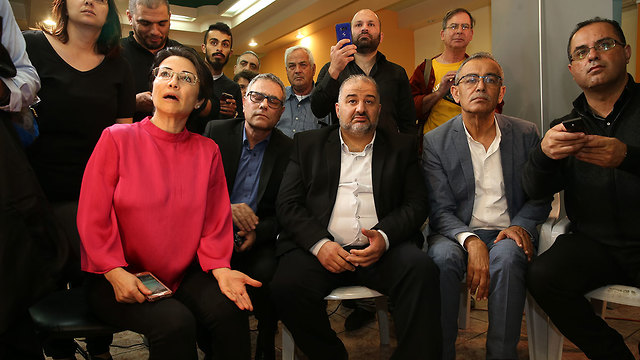 The Ra'am-Balad list reacts to exit polls in the April elections that showed they were in danger of missing the threshold for the Knesset (Photo: Elad Gershgoren)