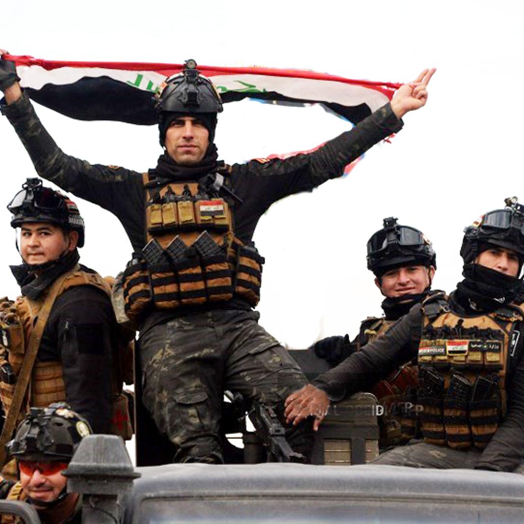 דצמבר 2018. חיילי צבא עיראק צוהלים אחרי שחרור העיר מוסול וחיסול דאעש