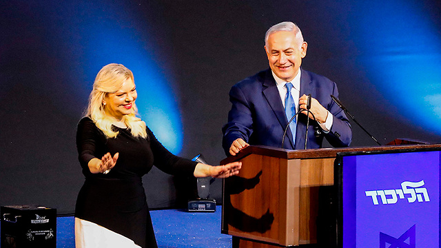 Benjamin and Sara Netanyahu on stage at Likud HQ in Tel Aviv  (Photo: AFP)