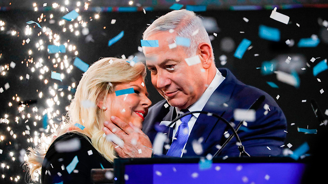 The Netanyahu couple following the election results (Photo: AFP)