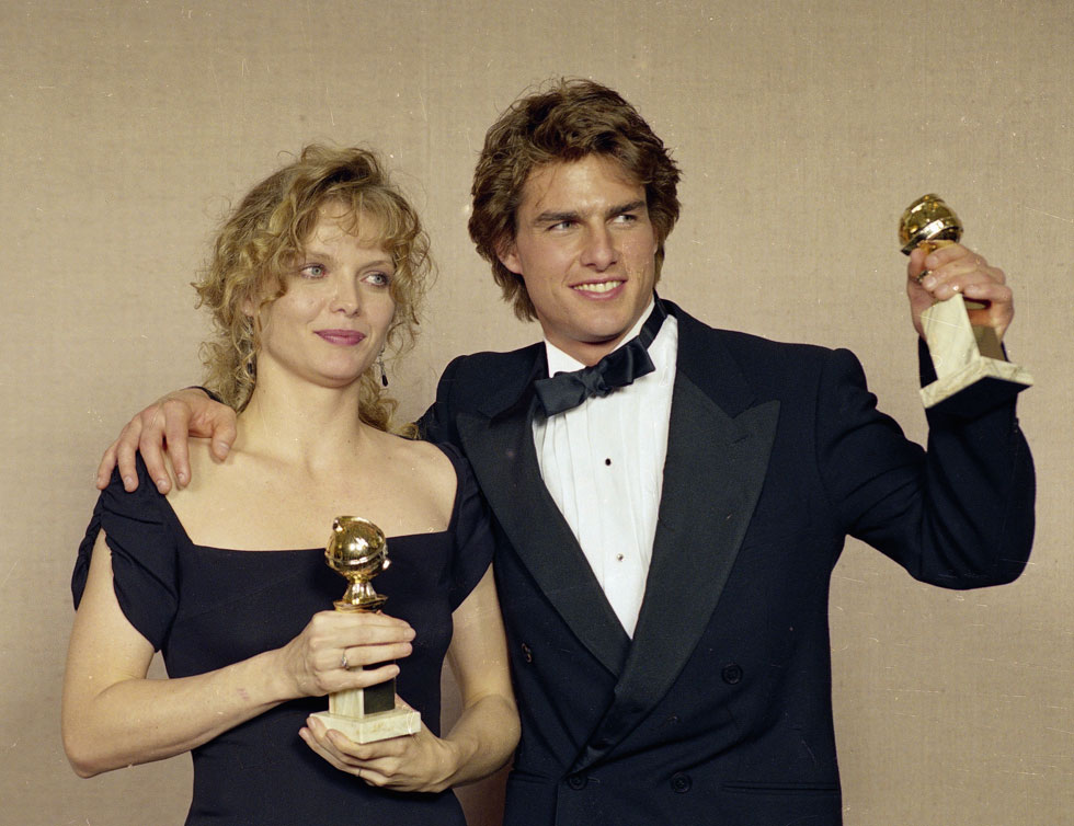 בשנת 1990 בחר בה לראשונה השבועון People לאישה היפה ביותר בעולם, כשמאז הוא מכתיר מדי שנה כוכבות נוספות. עם טום קרוז (צילום: AP)