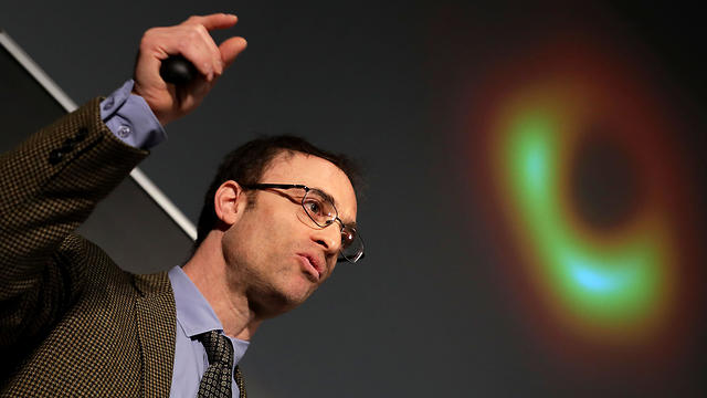 Event Horizon Telescope Director Sheperd Doeleman reveals the first photograph of a black hole during a news conference organized by the National Science Foundation at the National Press Club April 10, 2019 in Washington, DC.
