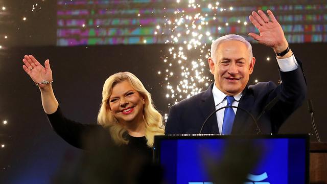 The Netanyahus celebrate with fireworks on election night (Photo: Reuters)