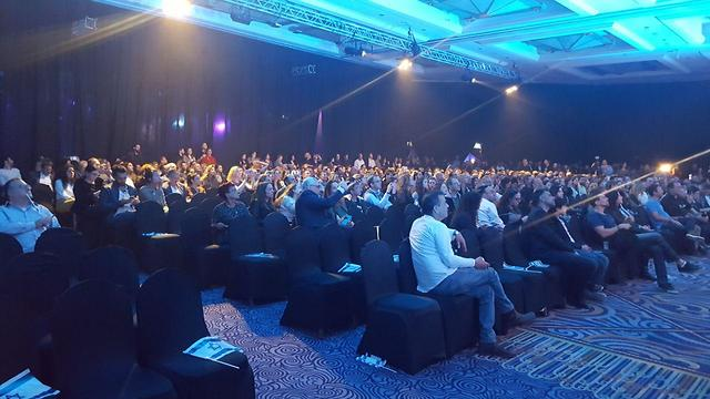 The audience that came to watch the landing at a Tel Aviv hotel