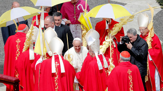Pope Francis greets cardinals at the end of the Palm Sunday Mass in Saint Peter's Square, at the Vatican, April 14, 2019