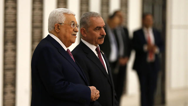 Palestinian President Mahmoud Abbas with Mohammed Shtayyeh (Photo: AFP)