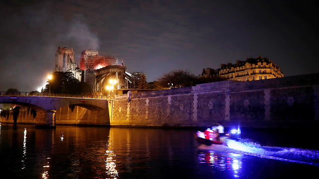 Flames rise over the Notre Dame (Photo: Reuters)
