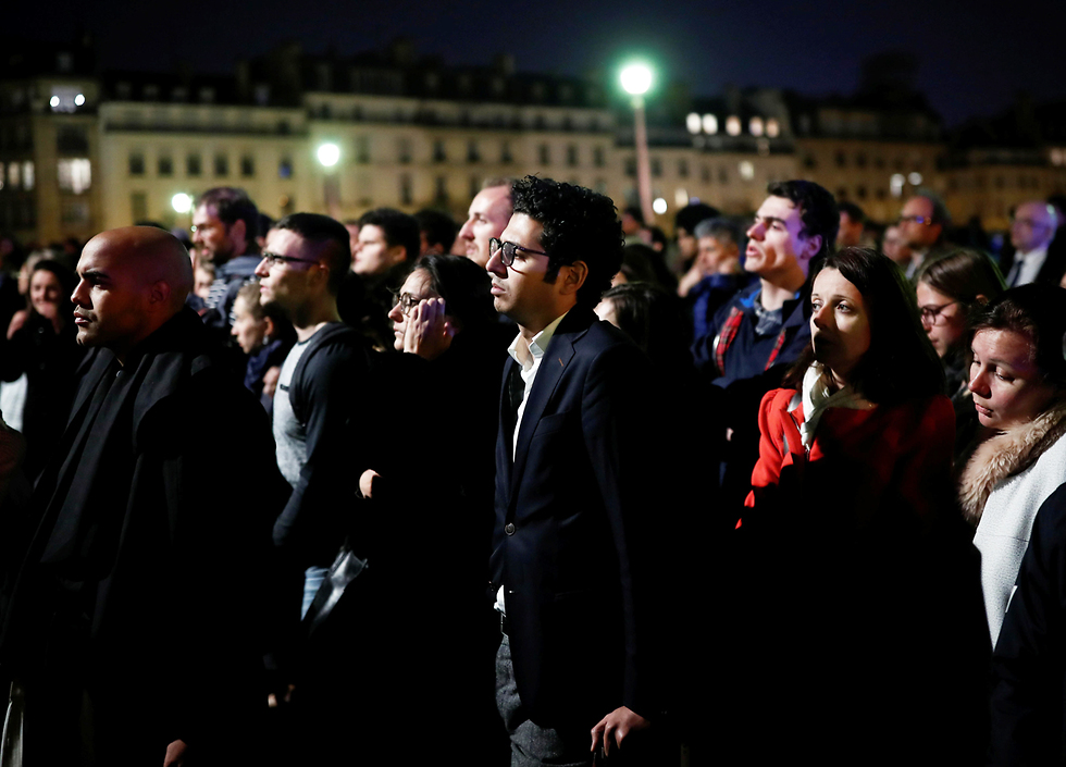 Crowds gather outside Notre Dame  (Photo: Reuters)