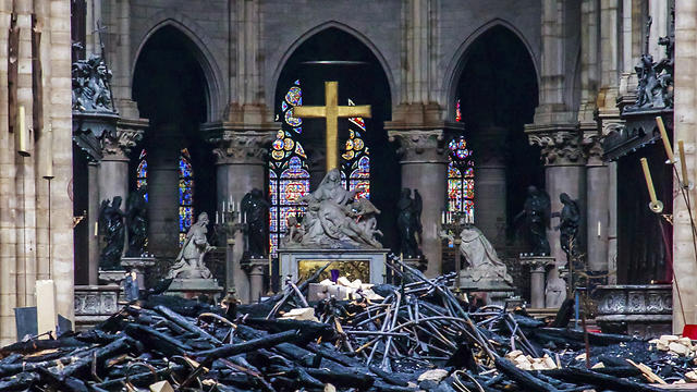 Debris are seen inside Notre Dame cathedral in Paris, Tuesday, April 16, 2019