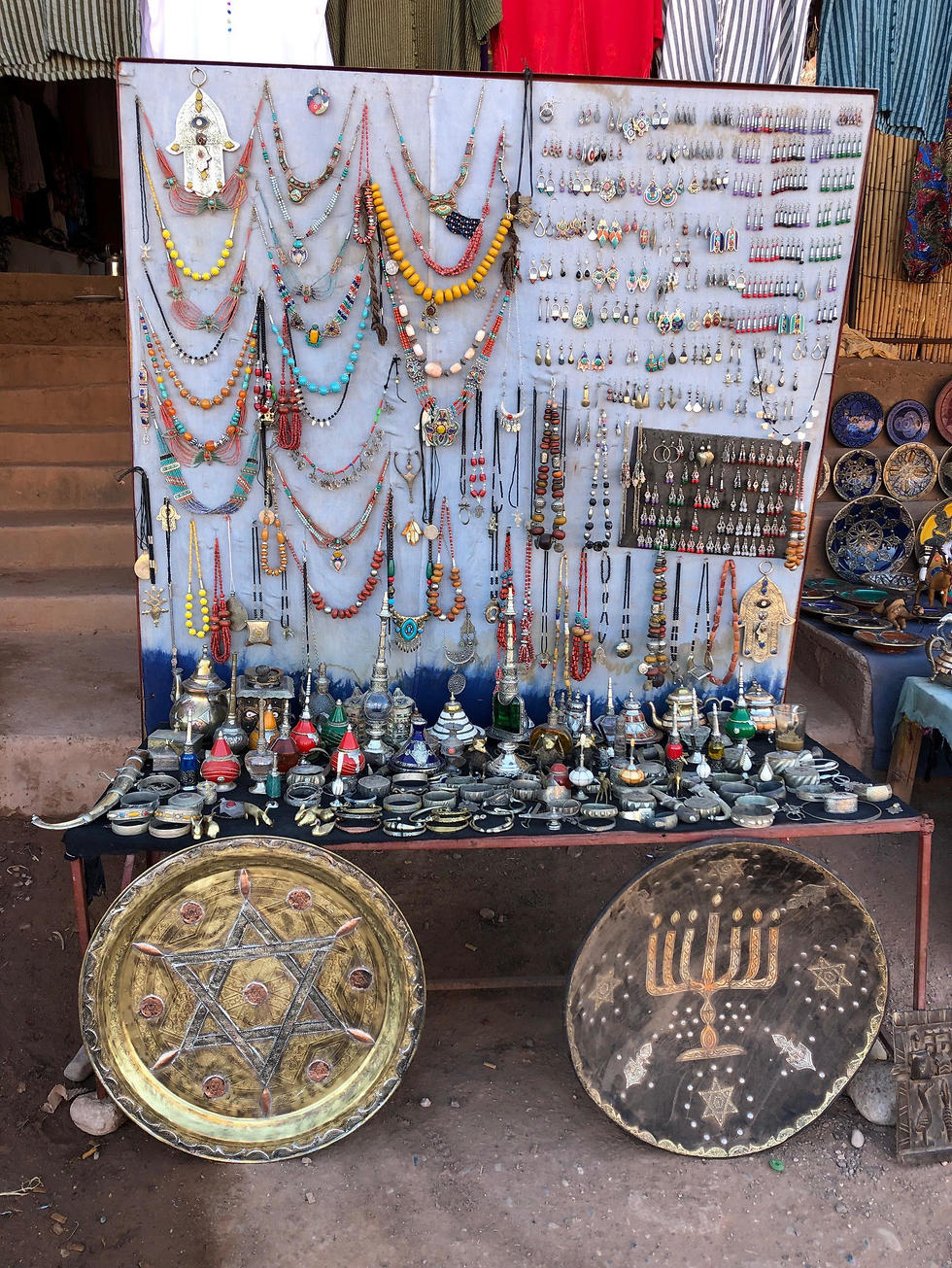 Platters adorned with a menorah and Jewish stars in an outdoor stall near Ksar of Ait-Ben-Haddou