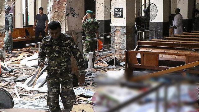 הרס ונזקים בעקבות הפיצוץ בכנסיית Kochchikade (צילום: AFP)