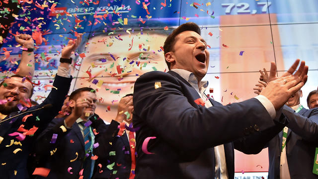 Ukrainian comedian and presidential candidate Volodymyr Zelensky reacts after the announcement of the first exit poll results in the second round of Ukraine's presidential election
