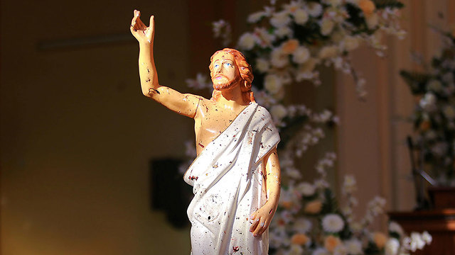 Blood stains are seen on a statue of Jesus Christ at St. Sebastian Catholic Church (Photo: Reuters)
