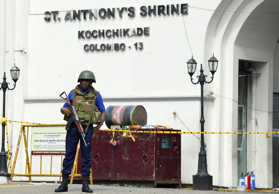 Police at the scene of one of the bombings (Photo: AFP)