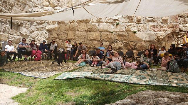 Children join in the Passover fun at the Tower of David