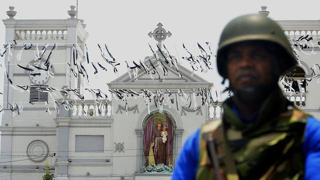Sri Lanakan soldier stands guard outside St. Anthony's Shrine in Colombo on April 25, 2019