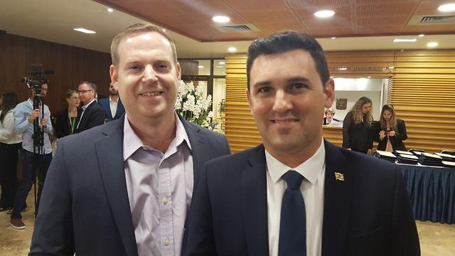 Member of Knesset Eitan Ginzburg (right) and his spouse Yotam at the opening session of the 21st Knesset