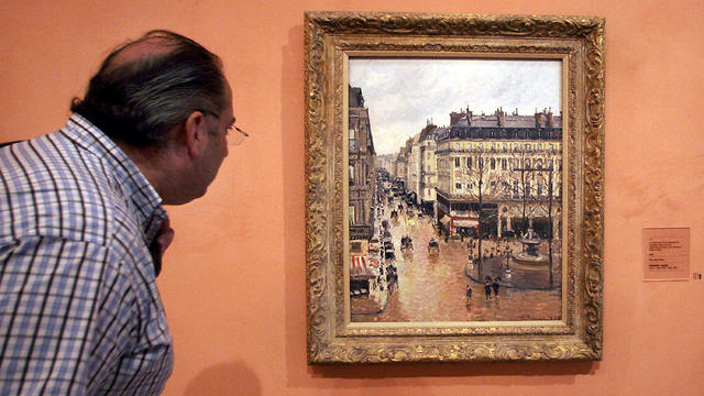 """""""Rue St.-Honore, Apres-Midi, Effet de Pluie"""" painted in 1897 by Camille Pissarro, on display in the Thyssen-Bornemisza Museum in Madrid"""