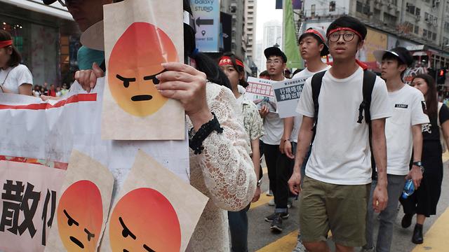חג הפועלים 1 במאי הונג קונג (צילום: AP)
