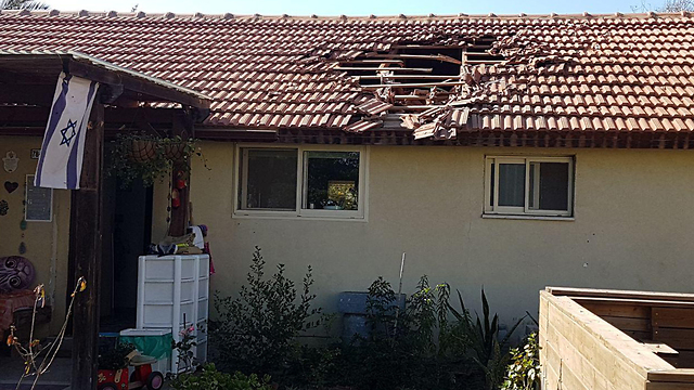 A home on Kibbutz Nahal Oz is hit by rocket fire