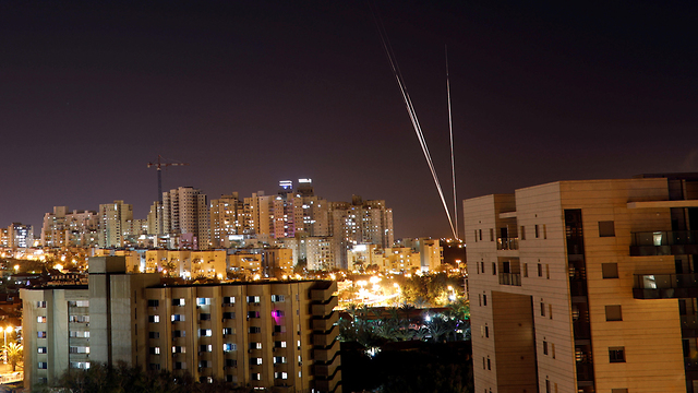 Rocket fire from Gaza at Ashdod on Saturday night  (Photo: Reuters)