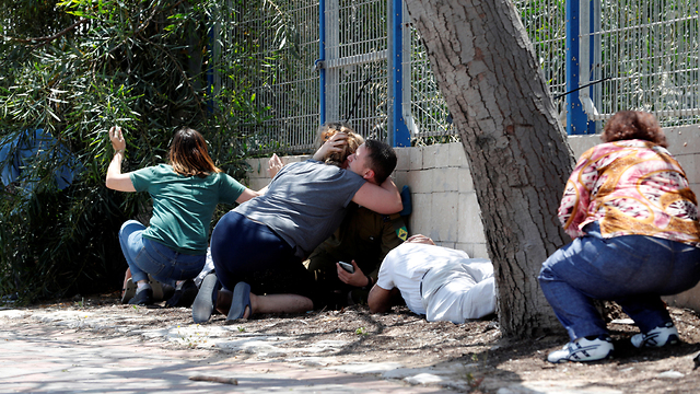 Residents of southern Israel try to take cover from rocket fire from Gaza (Photo: Reuters) (Photo: Reuters)