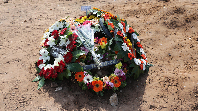 Grave of Moshe Agadi killed by rocket fire from Gaza (Photo: EPA)
