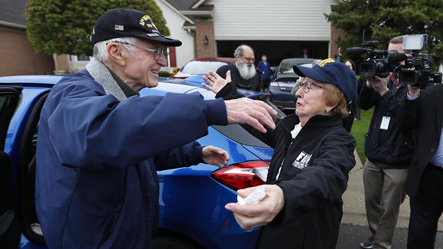Doug Harvey and holocaust survivor Sophie Tajch Klisman, right, greet each other  (Photo: AP) (Photo: AP)