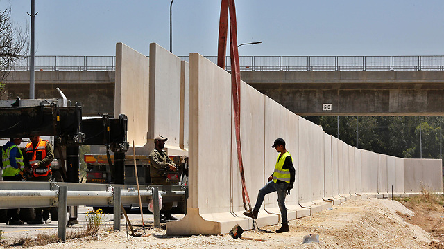 Concerete barriers are placed in Sderot to counter rocket fire from Gaza (Photo: AFP) (Photo: AFP)