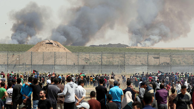 Palestinian protesters gathering at the Gaza border fence on Nakba Day (Photo: Reuters) (Photo: Reuters)