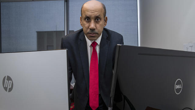 Ali al-Ahmed poses for a photograph in his office in Washington.