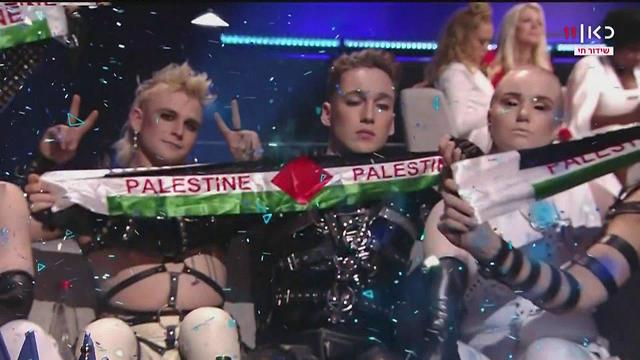 Iceland's band members hold up Palestinian flags during the Eurovision Grand Final (Photo courtesy of KAN)