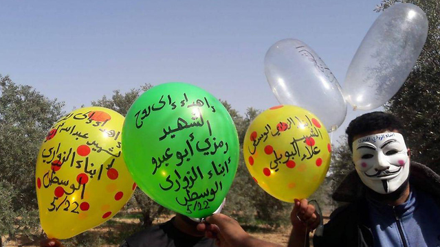 Balloons with explosive devices attached being launched from Gaza