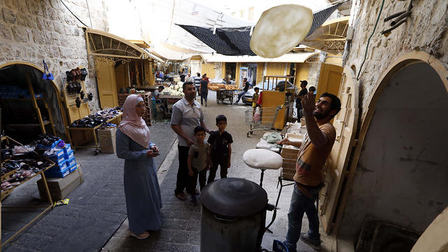 Palestinian baker prepares 'shrak' a traditional bread sold during Ramadan in Hebron