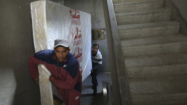 Yehiya Taleb (back), a new groom from Gaza, moves his wedding furniture to his apartment in the Shati refugee camp in Gaza City (Photo: AP)