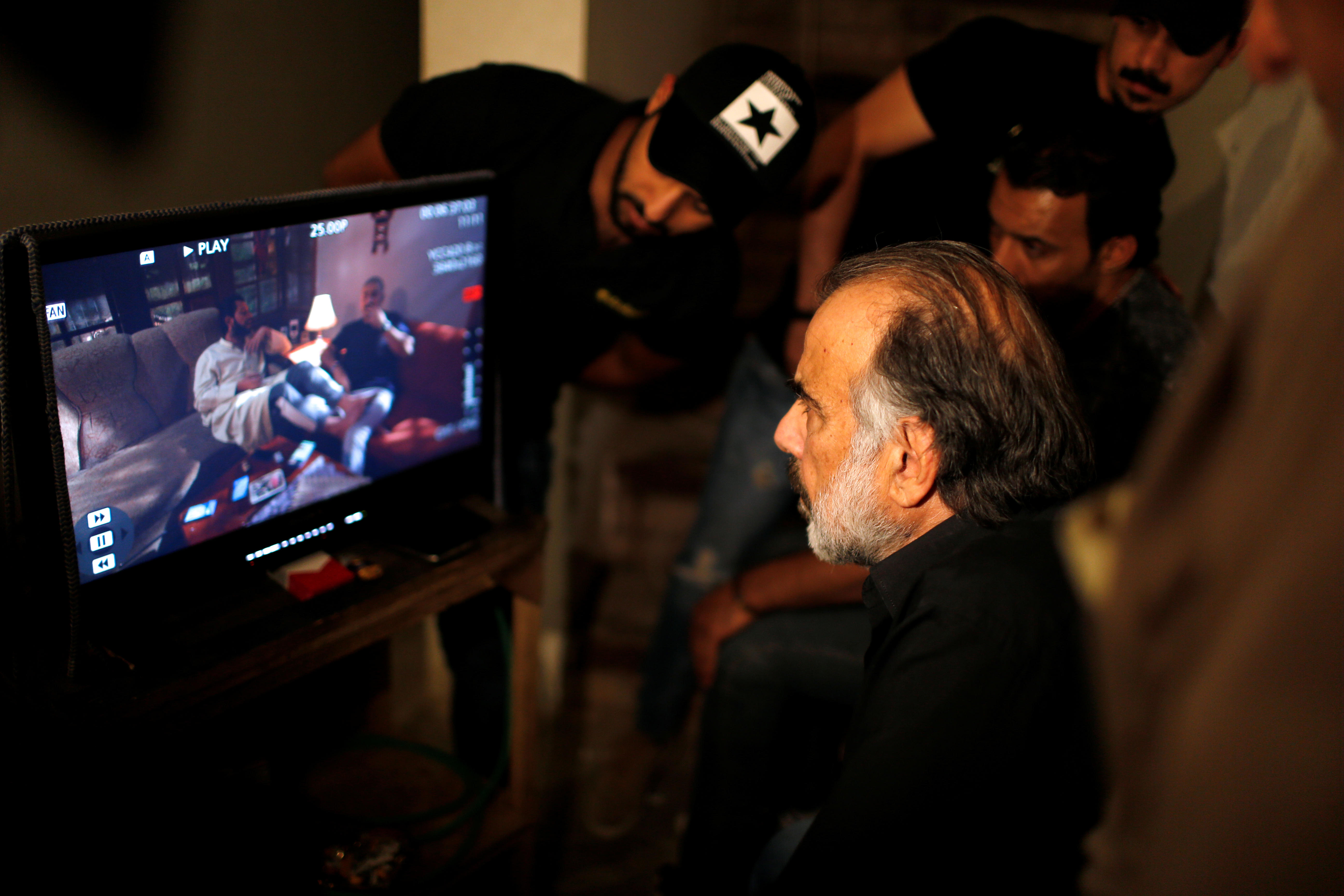 Director Hassan Husni watches actors perform during filming of Iraqi TV serial 'The Hotel,' May 12, 2019