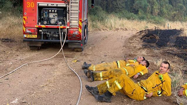 Firefighters resting near Tarom