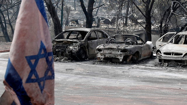 Moshav Mevo Modi'im, where 40 out 50 houses were damaged by fire (Photo: AFP)