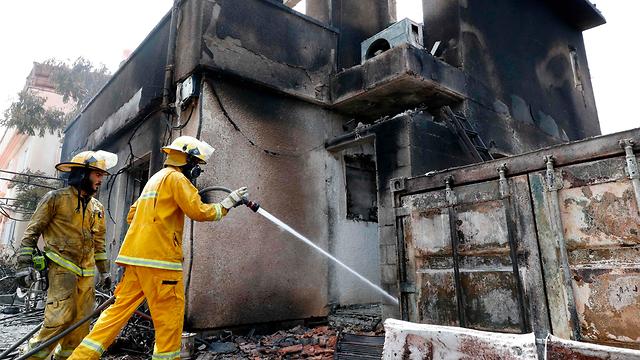 Moshav Mevo Modi'im damaged by fire (Photo: AFP)