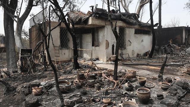 Aftermath of a fire in Mevo Modi'im (Photo: EPA)