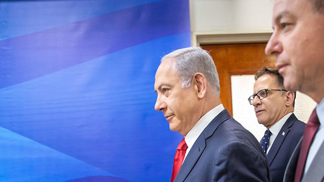 Benjamin Netanyahu heads to the weekly cabinet meeting in Jerusalem on Sunday (Photo: Emil Salman)