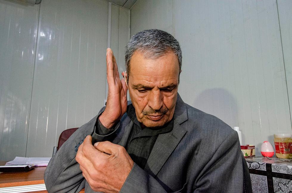 תושבים ב מוסול בית חולים אובדן שמיעה אחרי הניצחון על דאעש עיראק (צילום: AFP)