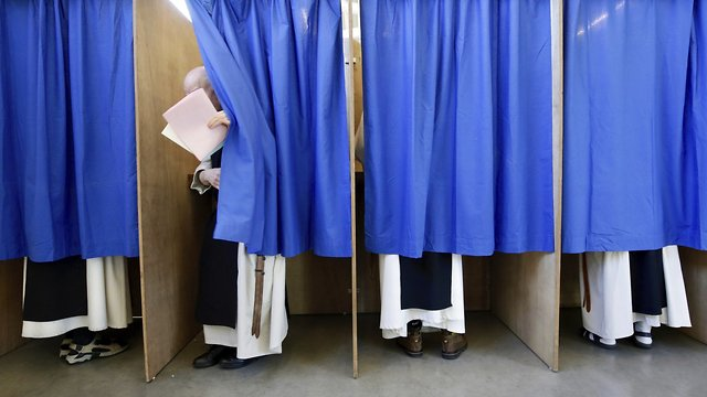 Monks from the Saint Sixtus Trappist Abbey in Belgium cast their votes in the European Parliament elections  (Photo: AP)