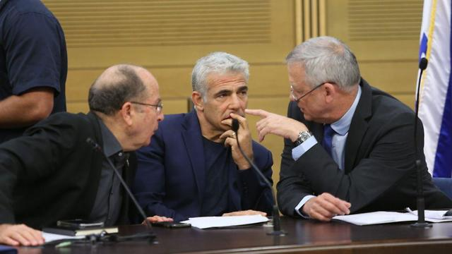 L-R: Moshe Ya'alon, Yair Lapid and Benny Gantz at a Blue and White factionm meeting Monday (Photo: Alex Kolomoisky) (Photo: Alex Kolomoisky)