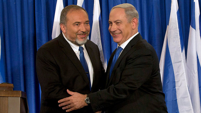 Avigdor Liberman with Benjamin Netanyahu as coalition partners in 2012 (Photo: AP)